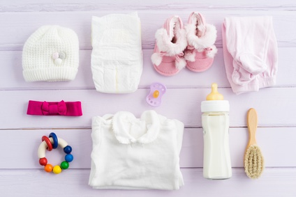 Collection of items for babies shot from above. Ideal website hero or header image