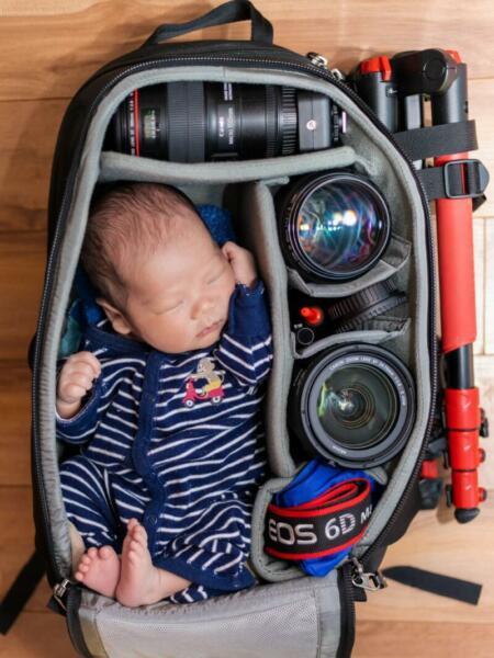 Baby in Kameratasche