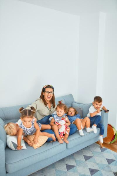 Women with kids on sofa